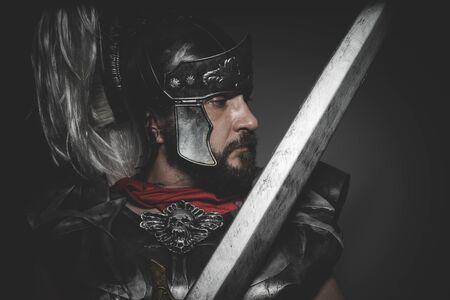 praetorian: Power, Praetorian Roman legionary and red cloak, armor and sword in war attitude