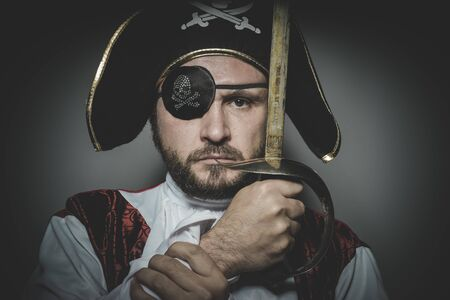 swashbuckler: Serious, man pirate with eye patch and old hat with funny faces and expressive