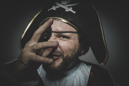 derision: Derision. man pirate with eye patch and old hat with funny faces and expressive Stock Photo