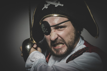 eye patch: Costume. man pirate with eye patch and old hat with funny faces and expressiveCostume. man pirate with eye patch and old hat with funny faces and expressive