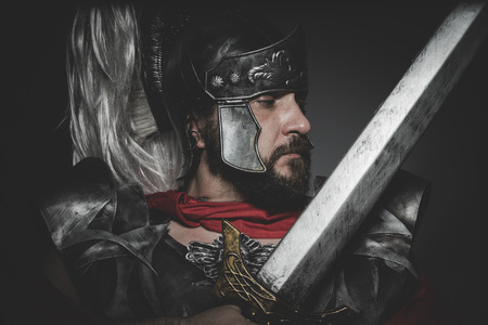 legionary: Praetorian Roman legionary and red cloak, armor and sword in war attitude Stock Photo