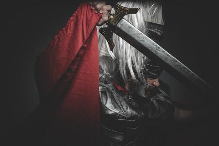praetorian: Armed, Praetorian Roman legionary and red cloak, armor and sword in war attitude