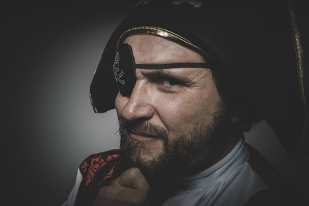 eye patch: Sexy man pirate with eye patch and old hat with funny faces and expressive Stock Photo
