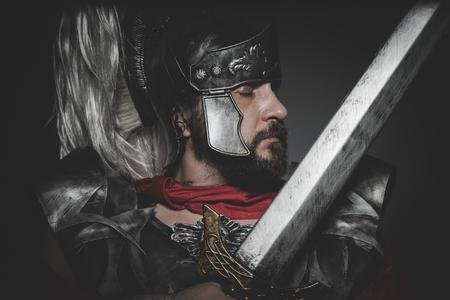 praetorian: Praetorian Roman legionary and red cloak, armor and sword in war attitude Stock Photo