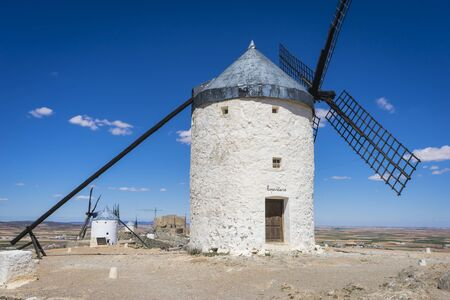 castile: windmills, cereal mills mythical Castile in Spain, Don Quixote, Castilian landscape with very old architecture