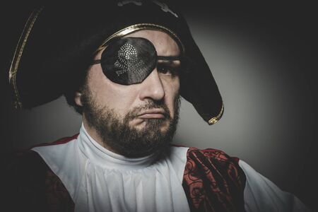 eye patch: Angry man pirate with eye patch and old hat with funny faces and expressive Stock Photo