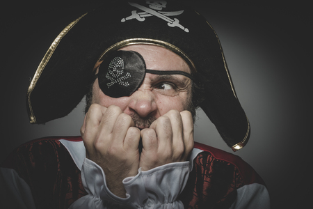 eye patch: Fear pirate with eye patch and old hat with funny faces and expressive Stock Photo