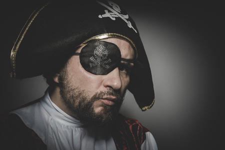 swashbuckler: Vintage, man pirate with eye patch and old hat with funny faces and expressive Stock Photo
