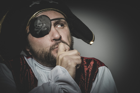 swashbuckler: Thinking, man pirate with eye patch and old hat with funny faces and expressive