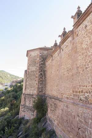 gargoyles: church facade with gargoyles in red, Villafam�s rural villa in Castellon, Valencia region in Spain Stock Photo