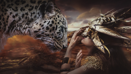 gold lace: Savage, brunette goddess dressed in gold lace dress. concept deity and faith Stock Photo