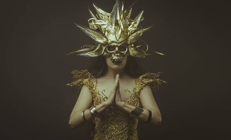 gold lace: Golden power, brunette goddess dressed in gold lace dress. concept deity and faith