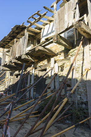 deteriorated: Ancient house restoration, wood and stone houses in the province of Zamora in Spain Stock Photo