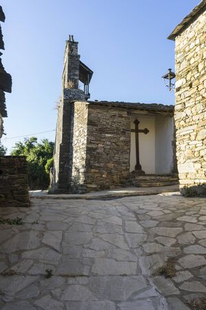 ruinous: Church gate, wood and stone houses in the province of Zamora in Spain