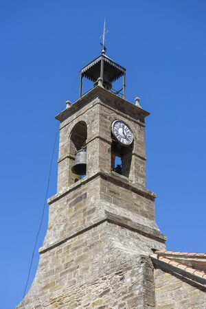 Clock tower and bell, ancient architecture inside Zamora, Spain, stone houses