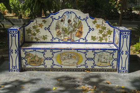plaza of arms: bank beautiful painted tile pieces in Marbella, Andalucia Spain