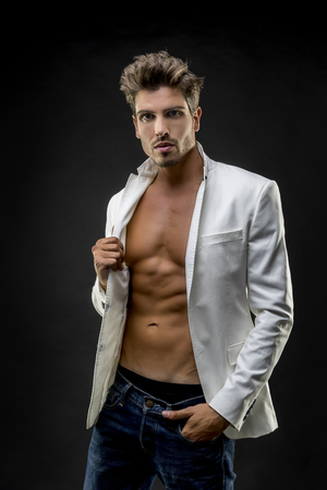 abdominals: Jacket, Young fashion model with abdominals and stylish clothes Stock Photo