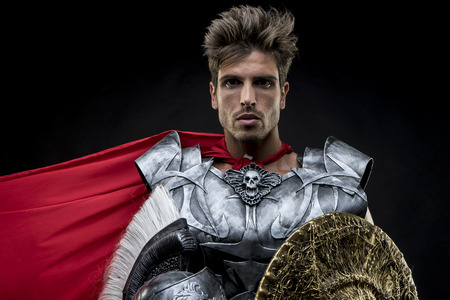 enactment: centurion or Roman warrior with iron armor, military helmet with horsehair and sword
