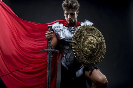 reenactment: Conqueror, centurion or Roman warrior with iron armor, military helmet with horsehair and sword