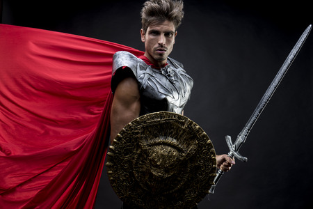Power, centurion or Roman warrior with iron armor, military helmet with horsehair and sword