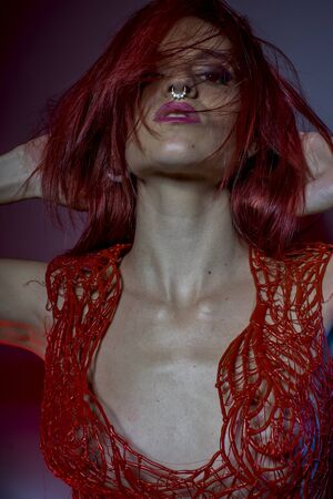 haircut: beautiful redhead with pierced nose and red corset lace frills wax