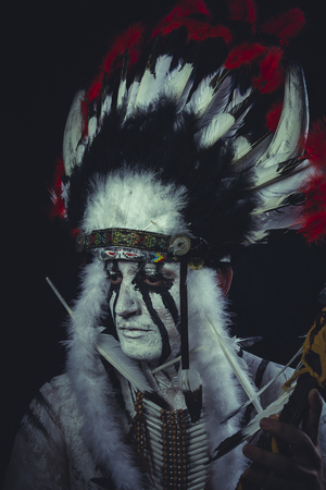 Geronimo, American Indian chief with feather headdress
