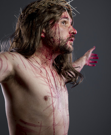 Jesus christ, jesus of nazareth with the crown of thorns and blood for his body as penance before the crucifixion Stock Photo