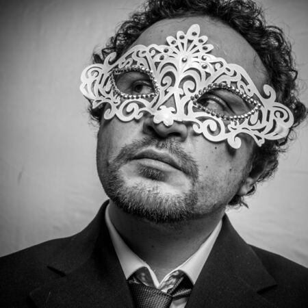 hypocrisy: Fraud, Sensual and mysterious businessman with white venetian mask