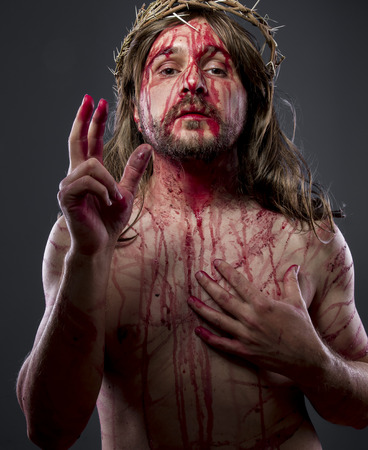 the scars: Jesus christ, jesus of nazareth with the crown of thorns and blood for his body as penance before the crucifixion Stock Photo