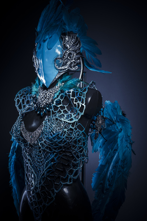 blind girl: Feathers, Handmade styling of a bird or mythological figure with blue wings and pieces of metal and precious stones