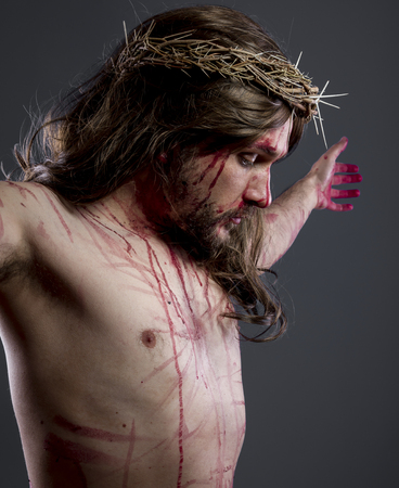 nazareth: Jesus christ, jesus of nazareth with the crown of thorns and blood for his body as penance before the crucifixion Stock Photo