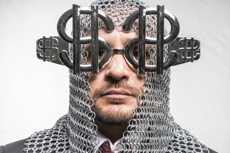 disapproving: Payday, man with medieval chain mail and dollar-shaped glasses