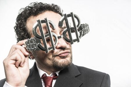Stubborn, Greed and money, businessman with dollar-shaped glasses, elegant tie suit