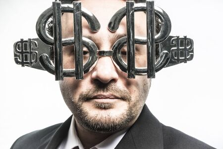 Rich, Greed and money, businessman with dollar-shaped glasses, elegant tie suit Stock Photo