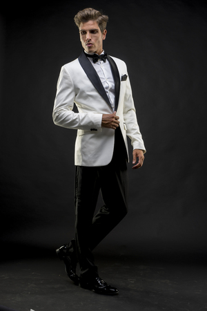 Celebration, Elegant and handsome man dressed in tuxedo for New Years Eve or party