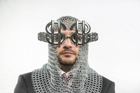 disapproving: Money Payday, man with medieval chain mail and dollar-shaped glasses Stock Photo