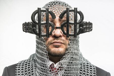 disapproving: Cash Payday, man with medieval chain mail and dollar-shaped glasses