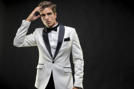 Elegant and handsome man dressed in tuxedo for New Years Eve or party