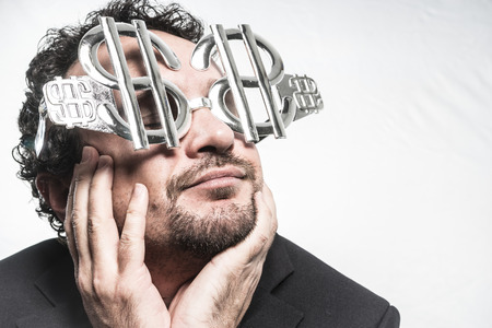 insidious: Greed and money, businessman with dollar-shaped glasses, elegant tie suit Stock Photo