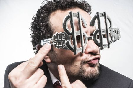 Greed and money, businessman with dollar-shaped glasses, elegant tie suit Stock Photo