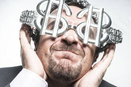 celos: Greed and money, businessman with dollar-shaped glasses, elegant tie suit Foto de archivo