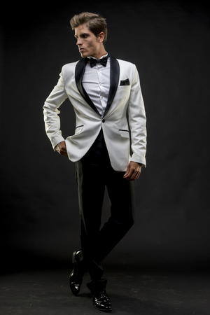man: Elegant and handsome man dressed in tuxedo for New Years Eve or party
