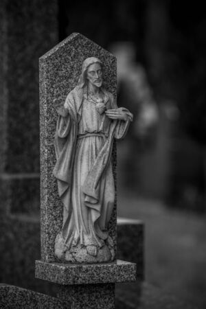 Tomb, Cemetery, details of crosses and tombs with sculptures of jesus christ and angels in spain Stock Photo