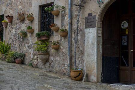 mallorca: rustic, flowerpots street in the tourist island of Mallorca, Valdemosa city in Spain Editorial
