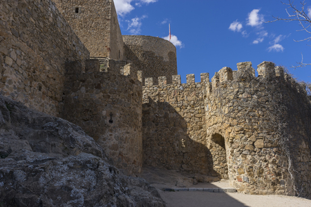 toledo town: Stone walls of a medieval castle. Town of Consuegra in the province of Toledo, Spain