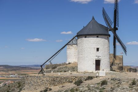 Windmill, White wind mills for grinding wheat. Town of Consuegra in the province of Toledo, Spain Stock Photo