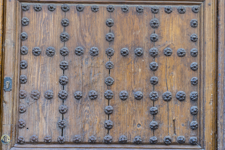 Wooden door with iron fasteners, City of Segovia, famous for its Roman aqueduct, in Spain