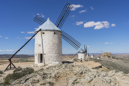 toledo town: Energy, White wind mills for grinding wheat. Town of Consuegra in the province of Toledo, Spain