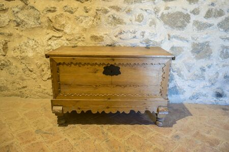 Wooden furniture, Interior of the medieval castle of the city of Consuegra in Toledo, Spain Editorial