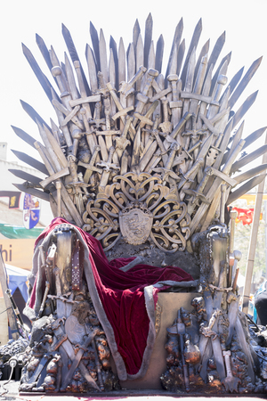 Power, Iron throne made with swords, fantasy scene or stage. Recreation of a medieval seat Editorial